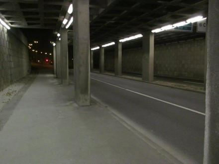 ... and in the darkened underpass ...